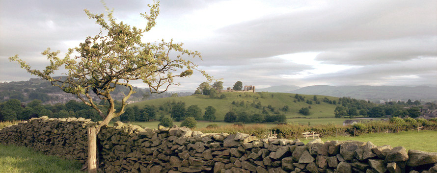 Kendal Castle at sunrise from Aikrigg